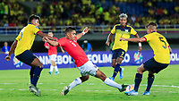 PEREIRA, COLOMBIA - JANUARY 18: Chile's Nicolas Guerra, (C) fights for the ball  against Ecuador's players Luis Segovia and Jordy Alcivar during their CONMEBOL Preolimpico soccer game at the Hernan Ramirez Villegas Stadium on January 18, 2020 in Pereira, Colombia. (Photo by Daniel Munoz/VIEW press/Getty Images)