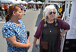 Darleen Campisi, of Byron's Hudson Valley Hearing Aid Center, seen with, Arzi McKeown, who organized the features of the Health Day theme, at the Saugerties Farmer's Market on Main Street in the Village of Saugerties, NY, on Saturday, June 10, 2017. Photo by Jim Peppler. Copyright/Jim Peppler-2017.
