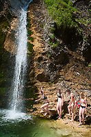 Trenta, Julian Alps, Slovenia, July 2011. Girls take a refreshing swim in the Slap Zadnja waterfalls after a hike up the Trenta Valley. Slovenia boasts a very spectacular carstic landscape with high limestone rock formations oozing with waterfalls, and fast flowing cristal clear waters that run through the Soca from the Triglav National Park to the Adriatic Sea. Photo by Frits Meyst/Adventure4ever.com