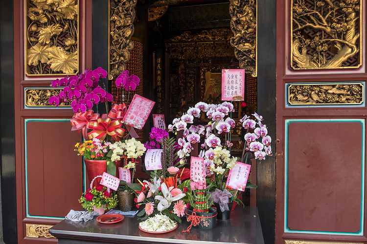 Calming effect of beautiful flower display at Taipei's Pao An Temple.