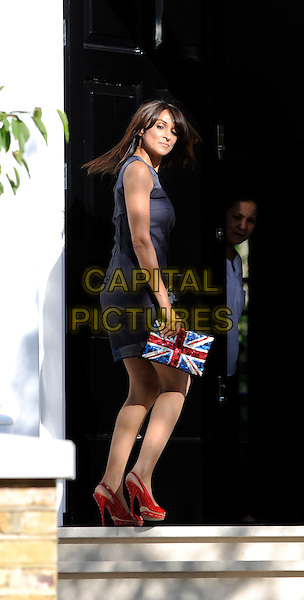 Jackie St Clair.arriving at Simon Cowell's home in Holland Park, London, England, UK,.3rd June 2011..full length black dress sleeveless union jack clutch bag peep toe shoes slingbacks door back over shoulder rear behind maid housekeeper .CAP/FIN.©Steve Finn/Capital Pictures.