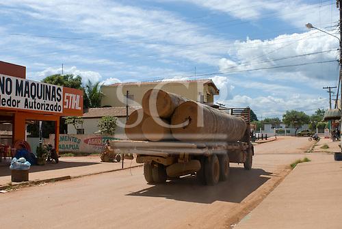 Pará State, Brazil. São Félix do Xingu. Battered illegal logging truck driving through the town.