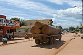 Pará State, Brazil. São Félix do Xingu. Battered illegal logging truck driving through the town.