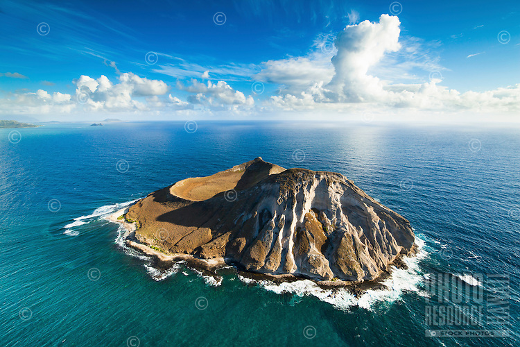 An aerial view of Rabbit Island, (a.k.a. Manana Island) at sunrise, with Lanikai in the far distance, O'ahu.