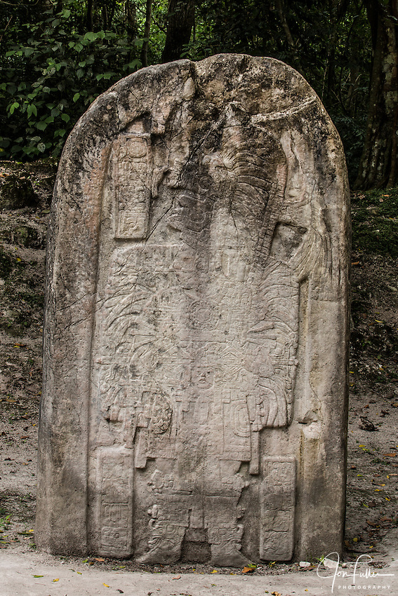 Stela 16 stone carving, circa 711 A.D.,  shows ruler Hasaw Kan K'awil wearing elaborate ritual dress for the celebration of an important ceremony.  Tikal National Park, Guatemala
