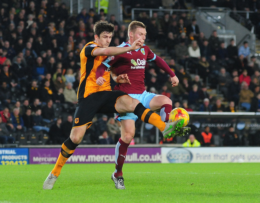Burnley&rsquo;s Rouwen Hennings vies for possession with Hull City's Harry Maguire<br /> <br /> Photographer Chris Vaughan/CameraSport<br /> <br /> Football - The Football League Sky Bet Championship - Hull City v Burnley - Saturday 26th December 2015 - Kingston Communications Stadium - Hull<br /> <br /> &copy; CameraSport - 43 Linden Ave. Countesthorpe. Leicester. England. LE8 5PG - Tel: +44 (0) 116 277 4147 - admin@camerasport.com - www.camerasport.com