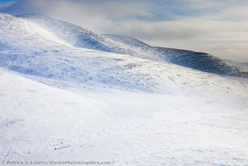 Musher Hugh Neff, who scratched due to logistical problems, heads through the Darby mountains on his way back to Nome  during the 2008 All Alaska Sweepstakes sled dog race.