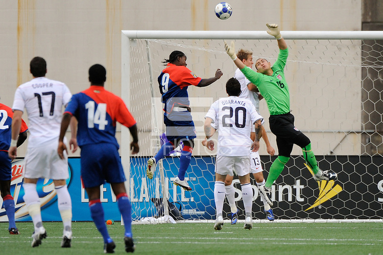United States (USA) goalkeeper Luis Robles (18) makes a save as Leonel Saint-Preux (9) of Haiti (HAI) goes up for a header during the first half of a CONCACAF Gold Cup Group B group stage match between the United States and Haiti at Gillette Stadium in Foxborough, MA, on July 11, 2009. .