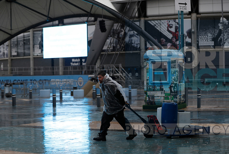 A worker outside the ground after the Premier League match between Manchester City and West Ham United was postponed because of weather conditions at the Etihad Stadium, Manchester. Picture date: 9th February 2020. Picture credit should read: Darren Staples/Sportimage