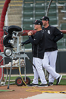 Kannapolis Intimidators hitting coach Justin Jirschele (left) and manager Cole Armstrong practice launching baseball into the outfield prior to a fielding practice at Kannapolis Intimidators Stadium on April 6, 2016 in Kannapolis, North Carolina.  (Brian Westerholt/Four Seam Images)