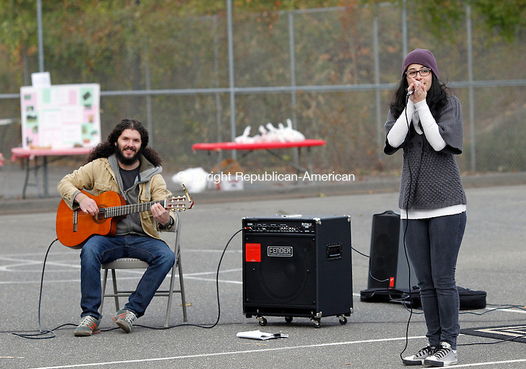 """Naugatuck, CT-13 October 2012-101312CM03-  Omar Castro, left of Columbia and Natali Mira, of West Haven, perform Latino Americano music with their group """"5 Below Zero"""" during a """"Celebration of People"""" event put on by the Naugatuck Cultural Council Saturday afternoon at Linden Park in Naugatuck.  The event featured multicultural performances including singing, dancing and music.  It also featured culturally diverse ethnic recipes.  The event was meant to bring together and celebrate the numerous heritages in Naugatuck and surrounding area.   Christopher Massa Republican-American"""