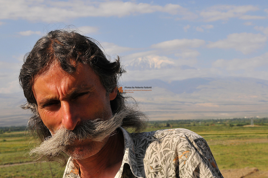 Portrait of Armenian farmer with  Ararat mountain in the backgraund