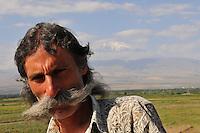 Portrait of Armenian farmer with  Ararat mountain in the backgraund