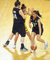 NZ's Jaimee-Lee Tito drives past Gems guard Tiana Mangakahia as Makayla Daysh runs interference during the 2012 FIBA Oceania Women's U19 Championship match between NZ Junior Tall Ferns and Australian Gems at Te Rauparaha Arena, Porirua, Wellington, New Zealand on Saturday, 22 September 2012. Photo: Dave Lintott / lintottphoto.co.nz