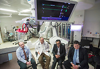 NWA Democrat-Gazette/BEN GOFF @NWABENGOFF<br /> Dr. Anton Cherney (from left), cardiothoracic surgeon, Dr. Lance Weathers, interventional cardiologist, Dr. Amr El-Shafei, interventional cardiologist, and Dr. Matthew Parmley, cardiothoracic surgeon, talk Wednesday, Feb. 28, during a press event about Mercy's new capability to perform transcatheter aortic valve replacement in the operating room used for the procedure at Mercy Hospital Northwest Arkansas in Rogers.
