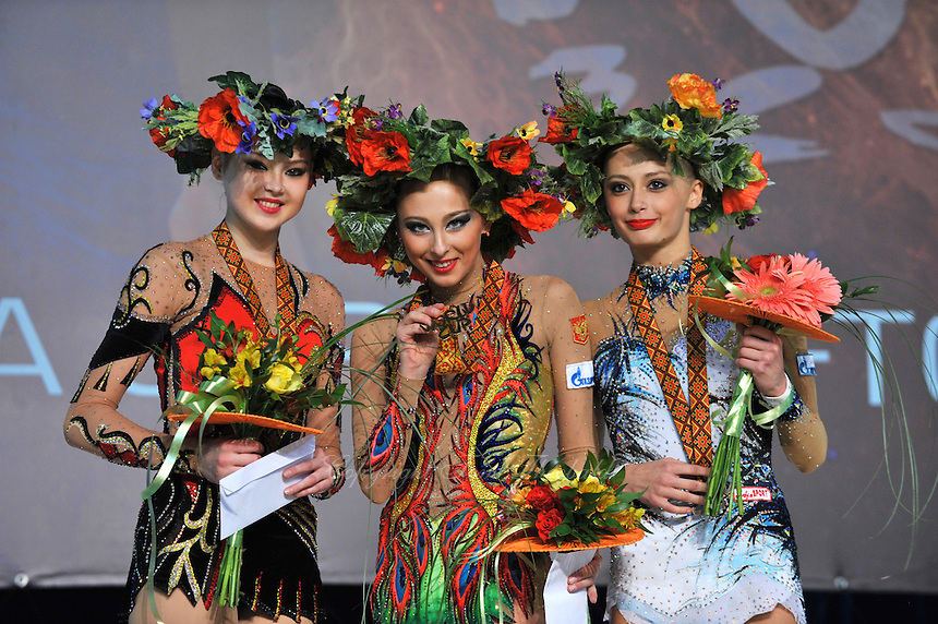 "(L-R) Winners in individual seniors All Around are: Alina Maksymenko  of Ukraine (silver), Daria Kondakova (gold) and Yana Lukonina of Russia (bronze) at 2011 World Cup Kiev, ""Deriugina Cup"" in Kiev, Ukraine on May 07, 2011."