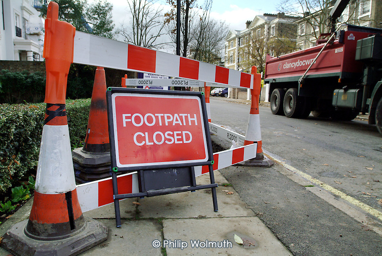 Pavement repairs in St.Johns Wood,  City of Westminster, London.