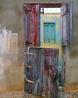 Anguilla, BWI<br /> Abandoned house with weathered paint and wooden doors near Anguilla's village of The Valley