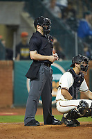 Home plate umpire Tanner Moore works the South Atlantic League game between the Hagerstown Suns and the Greensboro Grasshoppers at First National Bank Field on April 6, 2019 in Greensboro, North Carolina. The Suns defeated the Grasshoppers 6-5. (Brian Westerholt/Four Seam Images)