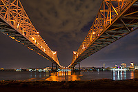 Mississippi river bridges in New Orleans or also called the Cresent bridge connection after dark.