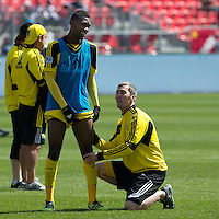 31 March 2011:  Columbus Crew defender Shaun Francis #29 gets some attention from the Columbus crew trainer during the warm-up in a game between the Columbus Crew and the Toronto FC at BMO Field in Toronto, Ontario Canada..The Columbus Crew won 1-0.