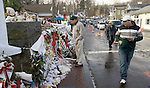 NEWTOWN, CT. 25 December 2012-122512SV03-People stream by an ever-growing memorial in Sandy Hook on Christmas Day in Newtown Tuesday..Steven Valenti Republican-American