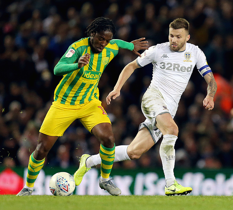 West Bromwich Albion's Romaine Sawyers under pressure from Leeds United's Stuart Dallas<br /> <br /> Photographer Rich Linley/CameraSport<br /> <br /> The EFL Sky Bet Championship - Tuesday 1st October 2019  - Leeds United v West Bromwich Albion - Elland Road - Leeds<br /> <br /> World Copyright © 2019 CameraSport. All rights reserved. 43 Linden Ave. Countesthorpe. Leicester. England. LE8 5PG - Tel: +44 (0) 116 277 4147 - admin@camerasport.com - www.camerasport.com