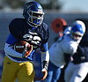 Kevon Hall #32 of Conference II/III (Roosevelt) runs the ball against Conference I/IV during the Nassau County Senior Bowl at Mitchel Athletic Complex in Uniondale on Thursday, Nov. 22, 2018.