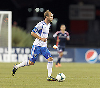 Montreal Impact midfielder Justin Mapp (21) brings the ball forward.  In a Major League Soccer (MLS) match, Montreal Impact (white/blue) defeated the New England Revolution (dark blue), 4-2, at Gillette Stadium on September 8, 2013.