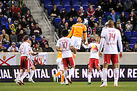 Brian Ching (25) of the Houston Dynamo goes up for a header. The New York Red Bulls  and the Houston Dynamo played to a 1-1 tie during a Major League Soccer (MLS) match at Red Bull Arena in Harrison, NJ, on April 02, 2011.