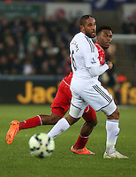 SWANSEA, WALES - MARCH 16: Daniel Sturridge of Liverpool (R) gets the ball past Ashley Williams of Swansea during the Premier League match between Swansea City and Liverpool at the Liberty Stadium on March 16, 2015 in Swansea, Wales