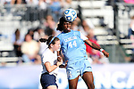 02 December 2012: UNC's Satara Murray (44) heads the ball over Penn State's Mallory Peterson (left). The University of North Carolina Tar Heels played the Penn State University Nittany Lions at Torero Stadium in San Diego, California in the 2012 NCAA Division I Women's Soccer College Cup championship game. UNC won the game 4-1.