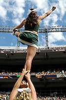 SEPTEMBER 17, 2011:   Colorado State Rams cheerleader is hoisted into the air   during an inter-conference game between the Colorado State Rams and the University of Colorado Buffaloes at Sports Authority Field at Mile High Field in Denver, Colorado. The Buffaloes led 14-7 at halftime*****For editorial use only*****