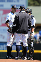 Empire State Yankees starting pitcher Andy Pettitte #46 talks with pitching coach Scott Aldred #57 and catcher Francisco Cervelli #3 a game against the Pawtucket Red Sox at Frontier Field on May 6, 2012 in Rochester, New York.  A regular season record of 13,584 fans, a sell out, attended the game as Pettitte allowed five runs on eight hits over five innings with five strikeouts and two walks in what is believed to be his last game in the minor leagues after coming out of retirement to pitch for the New York Yankees.  (Mike Janes/Four Seam Images)