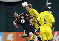 WASHINGTON, DC - AUGUST 4, 2012:  Maicon Santos (29) of DC United is knocked off the ball by Chad Marshall (14) of the Columbus Crew during an MLS match at RFK Stadium in Washington DC on August 4. United won 1-0.