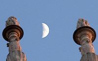La luna vista tra due decorazioni della facciata della Chiesa di Sant'Ignazio di Loyola illuminata dal sole al tramonto, in Campo Marzio a Roma, 26 gennaio 2015.<br /> The moon is seen between two sculptures decorating the facade of the Church of St. Ignatius of Loyola at Campus Martius, illuminated by the setting sun, in Rome, 26 January 2015.<br /> UPDATE IMAGES PRESS/Riccardo De Luca