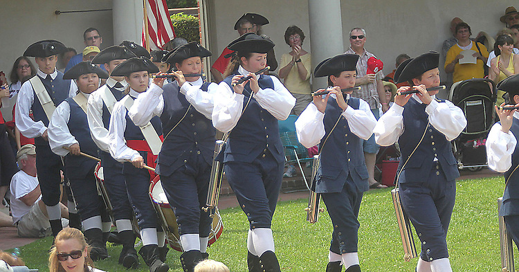 The Tryon Palace's Fife and Drum Corps march off after performing a short concert for the visitors Wednesday, celebrating the 4th of July, 07/04/2012.