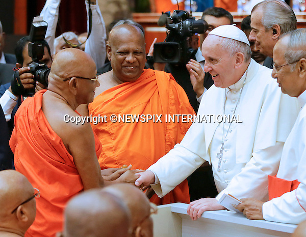 13.01.2015; Colombo, Sri Lanka: POPE FRANCIS <br /> attends an Inter-Religious Encounter at the BMICH on the first day of his 3-day visit to Sri Lanka.<br /> While in Sri Lanka, Pope Francis will perform the Canonization of Blessed Joseph Vaz and visit the Madhu Shrine in the predominantly Tamil area of the country.<br /> The Pope then continues his Asian tour with a visit to the Philipines.<br /> Mandatory Photo Credit: &copy;NEWSPIX INTERNATIONAL<br /> <br /> **ALL FEES PAYABLE TO: &quot;NEWSPIX INTERNATIONAL&quot;**<br /> <br /> PHOTO CREDIT MANDATORY!!: NEWSPIX INTERNATIONAL(Failure to credit will incur a surcharge of 100% of reproduction fees)<br /> <br /> IMMEDIATE CONFIRMATION OF USAGE REQUIRED:<br /> Newspix International, 31 Chinnery Hill, Bishop's Stortford, ENGLAND CM23 3PS<br /> Tel:+441279 324672  ; Fax: +441279656877<br /> Mobile:  0777568 1153<br /> e-mail: info@newspixinternational.co.uk