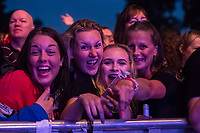 Fans getting ready to see The Human League perform during AmpRocks 2017, part of Ampthill Festival, at Ampthill Great Park, Ampthill, England on 30 June 2017. Photo by David Horn.