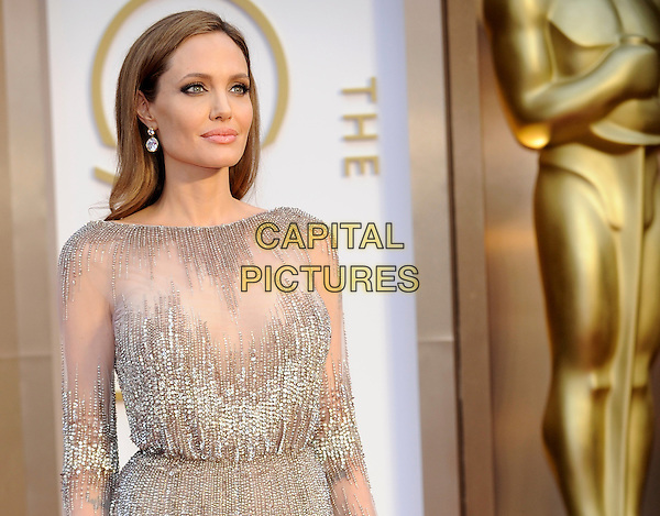 HOLLYWOOD, CA - MARCH 2: Angelina Jolie arriving to the 2014 Oscars at the Hollywood and Highland Center in Hollywood, California. March 2, 2014. <br /> CAP/MPI/COR<br /> &copy;Corredor99/ MediaPunch/Capital Pictures