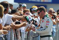 Oct 4, 2008; Talladega, AL, USA; NASCAR Sprint Cup Series driver Dale Earnhardt Jr signs autographs during qualifying for the Amp Energy 500 at the Talladega Superspeedway. Mandatory Credit: Mark J. Rebilas-