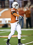 Texas Longhorns cornerback Adrian Phillips (17) warms up before the game between the Oklahoma State Cowboys and the University of Texas in Austin Texas Longhorns at the Daryl K. Royal- Texas Memorial Stadium in Austin, Texas. The Oklahoma State Cowboys defeated the Texas Longhorns 33 to 16.