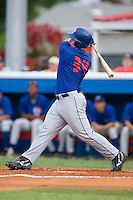 Pulaski Blue Jays right fielder Travis Snyder (34) follows through on his swing versus the Burlington Indians at Burlington Athletic Park in Burlington, NC, Saturday, July 29, 2006.  The Indians defeated the Blue Jays by the score of 8-4.