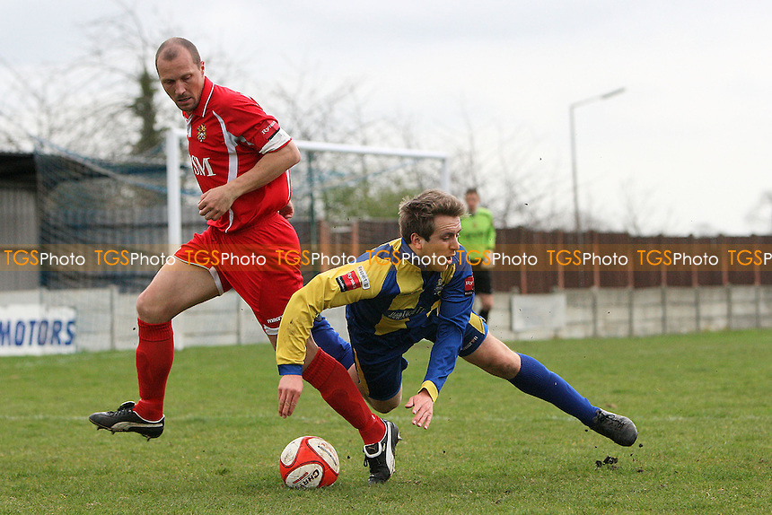 Kurt Smith of Romford tangles with Ryan Kirby of Harlow - Romford vs Harlow Town - Ryman League Division One North Football at Mill Field, Aveley FC - 17/03/12 - MANDATORY CREDIT: Gavin Ellis/TGSPHOTO - Self billing applies where appropriate - 0845 094 6026 - contact@tgsphoto.co.uk - NO UNPAID USE.