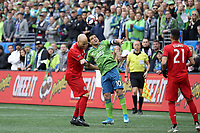 SEATTLE, WA - NOVEMBER 10: Michael Bradley #4 of Toronto FC and Nicolas Lodeiro #10 of the Seattle Sounders FC challenge for a header during a game between Toronto FC and Seattle Sounders FC at CenturyLink Field on November 10, 2019 in Seattle, Washington.