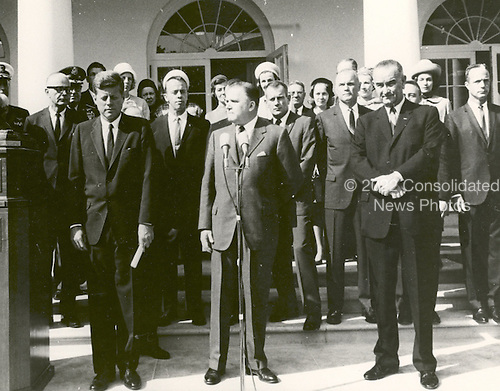 """NASA Administrator James E. Webb (center) cites the space achievements of the Project Mercury Astronauts who received the 1963 Collier Trophy Award in a ceremony held at the White House on October 10, 1963. President John F. Kennedy (left) and Vice President Lyndon Johnson accompanied Webb at the ceremony. Five of the Mercury Seven astronauts are visible in the row behind James Webb. They are (starting from JFK's left): Alan Shepard, Donald """"Deke"""" Slayton, John Glenn, Virgil """"Gus"""" Grissom, and Scott Carpenter..Credit: NASA via CNP"""