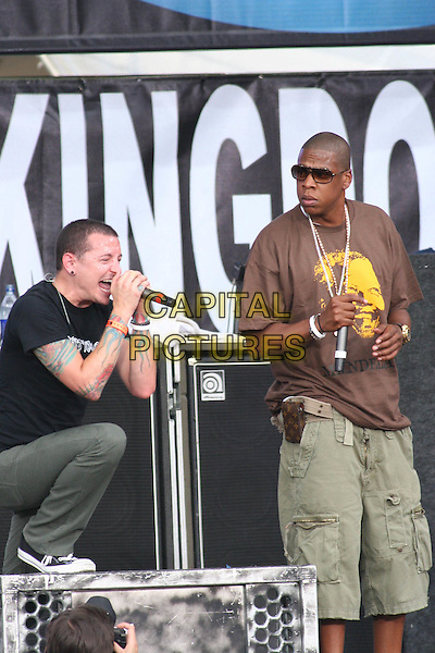 LINKIN PARK - CHESTER BENNINGTON & JAY-Z.Perfom at Live 8 Philadelphia - A concert to raise awareness for an end to extreme poverty in Africa (Make Poverty History) ahead of the G8 Summit taking place later this week. .Philadelphia Museum of Art, Philadelphia, .Pennsylvania, USA, July 2nd 2005..half length gig makepovertyhistory live8 aid tattoo leg up  jay Z Nelson Mandela face logo.Ref: IW.www.capitalpictures.com.sales@capitalpictures.com.©Ian Wilson/Capital Pictures.