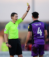 Port Vale's Luke Joyce is shown a yellow card by referee Peter Wright<br /> <br /> Photographer Chris Vaughan/CameraSport<br /> <br /> The EFL Sky Bet League Two - Lincoln City v Port Vale - Tuesday 1st January 2019 - Sincil Bank - Lincoln<br /> <br /> World Copyright © 2019 CameraSport. All rights reserved. 43 Linden Ave. Countesthorpe. Leicester. England. LE8 5PG - Tel: +44 (0) 116 277 4147 - admin@camerasport.com - www.camerasport.com