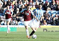 Burnley's Johann Gudmundsson passes under pressure from Huddersfield Town's Mathias Zanka Jorgensen<br /> <br /> Photographer Rich Linley/CameraSport<br /> <br /> The Premier League - Burnley v Huddersfield Town - Saturday 6th October 2018 - Turf Moor - Burnley<br /> <br /> World Copyright &copy; 2018 CameraSport. All rights reserved. 43 Linden Ave. Countesthorpe. Leicester. England. LE8 5PG - Tel: +44 (0) 116 277 4147 - admin@camerasport.com - www.camerasport.com