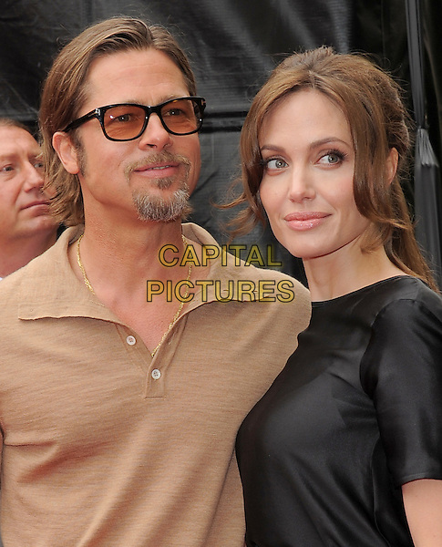 BRAD PITT & ANGELINA JOLIE.at The Dreamworks Animation L.A. Premiere of 'Kung Fu Panda 2' held at The Grauman's Chinese Theatre in Hollywood, California, USA,.May 22nd 2011..portrait headshot couple glasses tinted sunglasses beige brown top shirt black goatee facial hair beard                                                                                .CAP/RKE/DVS.©DVS/RockinExposures/Capital Pictures.